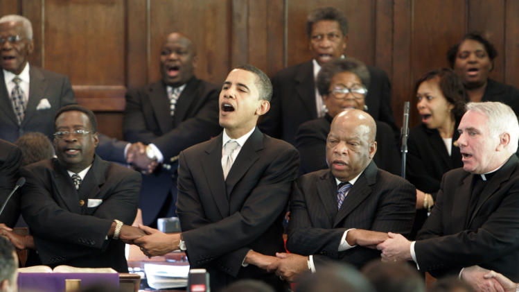 FILE - In this Sunday March 4, 2007 file photo, from left, Brown Chapel AME Church pastor James Jackson, Democratic presidential candidate Sen. Barack Obama, D-Ill., Rep. John Lewis, D-Georgia, and Rev. Clete Kiley, hold hands and sing at the end of a church service in Selma, Ala. on the commemoration of the Rev. Martin Luther King Jr. protest march from Selma to Montgomery, Ala. How unthinkable it was, not so long ago, that a presidential election would pit a candidate fathered by an African against another condemned as un-Christian. And yet, here it is: Barack Obama vs. Mitt Romney, an African-American and a white Mormon, representatives of two groups and that have endured oppression to carve out a place in the United States. How much progress has America made against bigotry? (AP Photo/Rob Carr)
