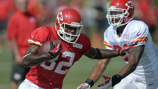 Kansas City Chiefs receiver Dwayne Bowe (82) runs past a defender during an NFL football training camp Monday, July 28, 2014, on the Missouri Western State University campus in St. Joseph, Mo