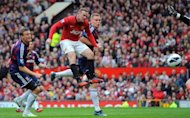 Manchester United's English forward Wayne Rooney (2ndL) scores during their English Premier League football match at Old Trafford in Manchester