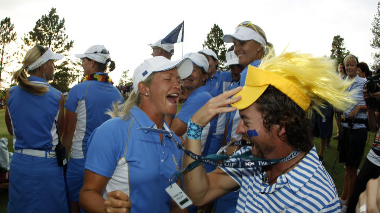 Europe's Caroline Hedwall, from Sweden, celebrates with fans after she and her teammates beat Team USA and clinched the Solheim Cup golf tournament, Sunday, Aug. 18, 2013, in Parker, Colo. (AP Photo/David Zalubowski)