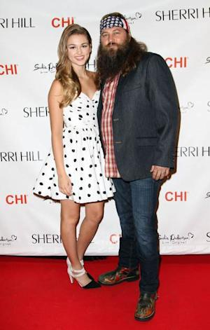 Sadie Robertson and Willie Roberston attend an Evening By Sherri Hill fashion show during Mercedes-Benz Fashion Week Spring 2014 at Trump Tower on September 9, 2013 in New York City -- Getty Images