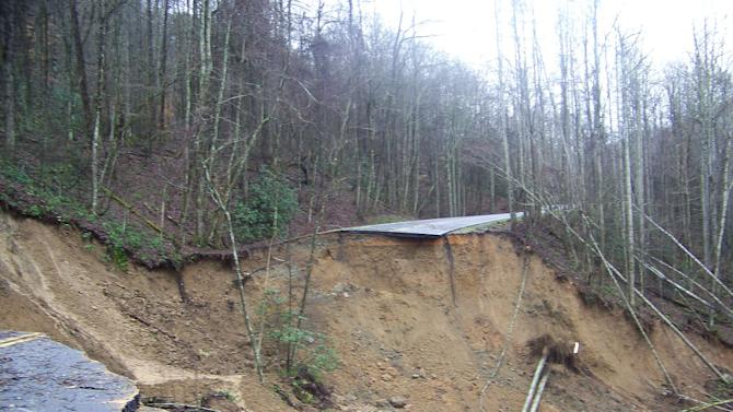 This photo provided by the National Park Service shows the result of a landslide on Newfound Gap Road (U.S. 441) on Wednesday, Jan. 16, 2013, in the Great Smoky Mountains National Park. The slide, estimated to have taken out a 200-foot section of road between the Collins Creek picnic area and Webb Overlook, is expected to cause closure of the road for an extended period according to park officials. (AP Photo/National Park Service)