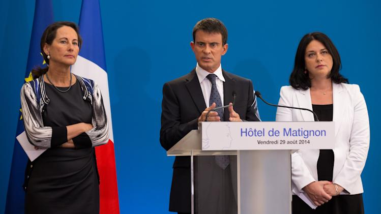 French Minister for Ecology, Sustainable Development and Energy Royal, Prime Minister Valls and Housing minister Pinel attend a news conference at the Hotel Matignon offices in Paris