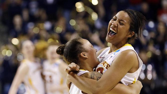 """Iowa State's Brynn Williamson, right, is embraced by Nicole """"Kidd"""" Blaskoway after the team defeated Gonzaga 72-60 in a first-round game in the women's NCAA college basketball tournament in Spokane, Wash., Saturday, March 23, 2013. (AP Photo/Elaine Thompson)"""