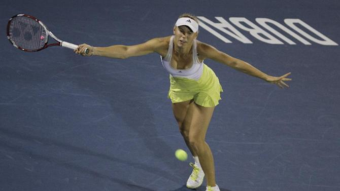 Denmark's Caroline Wozniacki returns the ball to Lucie Safarova from Czech Republic during the second day of Dubai Duty Free Tennis Championships in Dubai, United Arab Emirates, Tuesday, Feb. 19, 2013. (AP Photo/Kamran Jebreili)
