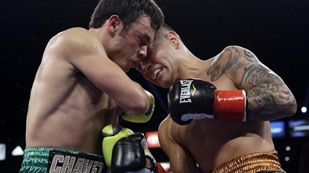 Julio Cesar Chavez Jr., left, and Bryan Vera butt heads in the second round of a 10-round boxing match (AP Photo/Reed Saxon)