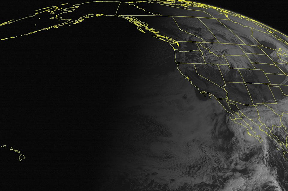 This NOAA satellite image taken Tuesday, October 16, 2012 at 11:00 AM EDT shows Hurricane Paul over Baja Peninsula with maximum sustained winds 90mph. Rain showers associated with a cold front moves into the Northern Rockies. (AP PHOTO/WEATHER UNDERGROUND)