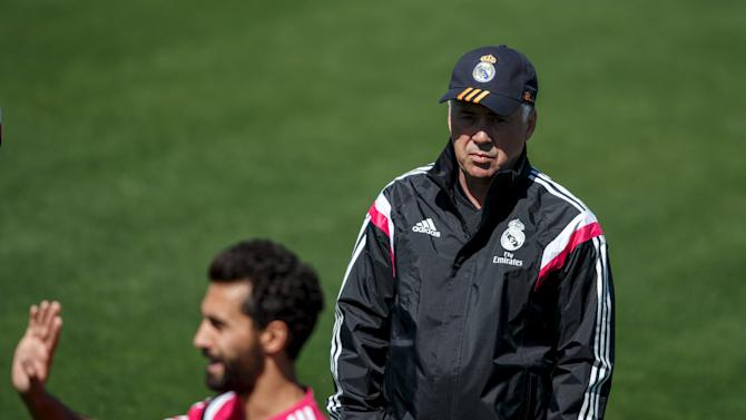 Real Madrid coach Carlo Ancelotti attends a training session at Valdebebas, outside Madrid, Spain