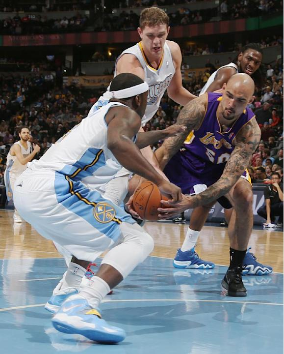 Los Angeles Lakers center Robert Sacre, right, struggles to recover a loose ball as, from front left to back, Denver Nuggets guard Ty Lawson, center Timofey Mozgov, of Russia, and forward Kenneth Fari