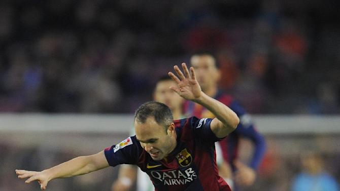 FC Barcelona's Andres Iniesta, left, duels for the ball against Cordoba's Aleksandar Pantic during a Spanish La Liga soccer match at the Camp Nou stadium in Barcelona, Spain, Saturday, Dec. 20, 2014. (AP Photo/Manu Fernandez)