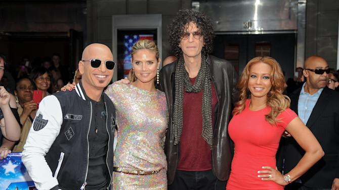 "FILE - In this April 9, 2013 photo, celebrity judges, from left, Howie Mandel, Heidi Klum, Howard Stern and Melanie ""Mel B."" Brown arrive at the ""America's Got Talent"" auditions in New York. The 10th season premieres Tuesday, May 26, at 8 p.m. ET. (Photo by Evan Agostini/Invision/AP, File)"