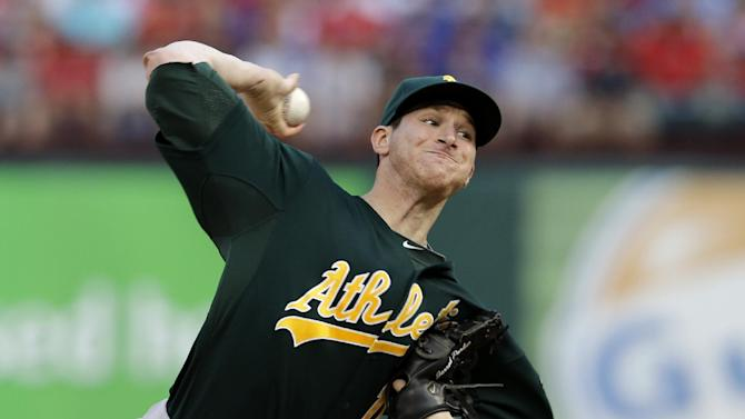 Oakland Athletics starting pitcher Jarrod Parker  works against the Texas Rangers in the first inning of a baseball game Tuesday, June 18, 2013, in Arlington, Texas. (AP Photo/Tony Gutierrez)