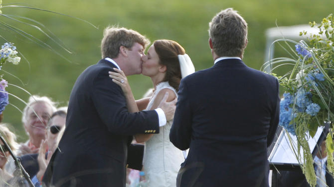 Former U.S. Rep. Patrick Kennedy, D-R.I., the son of the late U.S. Sen. Edward Kennedy, kisses his wife Amy Petitgout during their wedding ceremony at the Kennedy Compound in Hyannisport, Mass., Friday, July 15, 2011. At right is Kennedy's brother Edward Kennedy Jr.  (AP Photo/Charles Krupa)