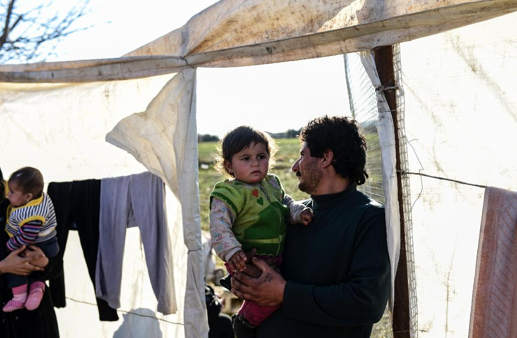 Turkey says 100,000 refugees in border camps inside Syria