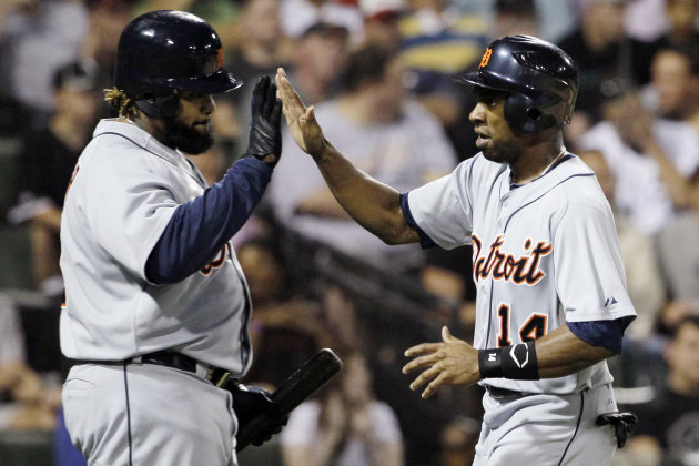 Detroit Tigers&#39; Austin Jackson, right, celebrates with Prince Fielder after scoring on a single hit by Miguel Cabrera during the fifth inning of a baseball game against the Chicago White Sox in Chicago, Wednesday, Sept. 12, 2012. (AP Photo/Nam Y. Huh)