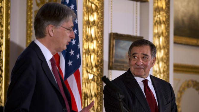 """Britain's Secretary of State for Defense Philip Hammond, left, speak to the media with U.S. Defense Secretary Leon Panetta during a news conference at Lancaster House in London on Saturday, Jan. 19, 2013. Britain's defense minister says it appears the hostage situation in Algeria has come to an end and resulted in further loss of life. Philip Hammond calls the loss of life appalling and unacceptable. He says """"it is the terrorists that bear the sole responsibility for it."""" Hammond spoke at the start of a news conference with U.S. Defense Secretary Leon Panetta.  (AP Photo/Jacquelyn Martin)"""