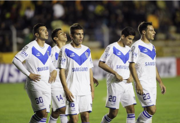 Soccer players of Argentina's Velez Sarsfield leave the field after their Copa Libertadores soccer match against Bolivia's The Strongest