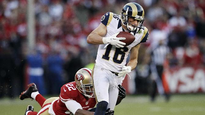 St. Louis Rams wide receiver Danny Amendola (16) runs as San Francisco 49ers cornerback Carlos Rogers (22) dives behind on a play that was called back by penalty during overtime of an NFL football game in San Francisco, Sunday, Nov. 11, 2012. San Francisco and St. Louis tied their game 24-24. (AP Photo/Jeff Chiu)