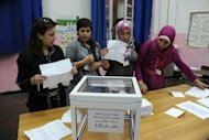 File picture shows officials counting votes in Algiers, May 10. US Secretary of State Hillary Clinton has hailed Algeria's elections, despite widespread suspicion over results that saw the regime tighten its grip on power, bucking the Arab Spring trend of change