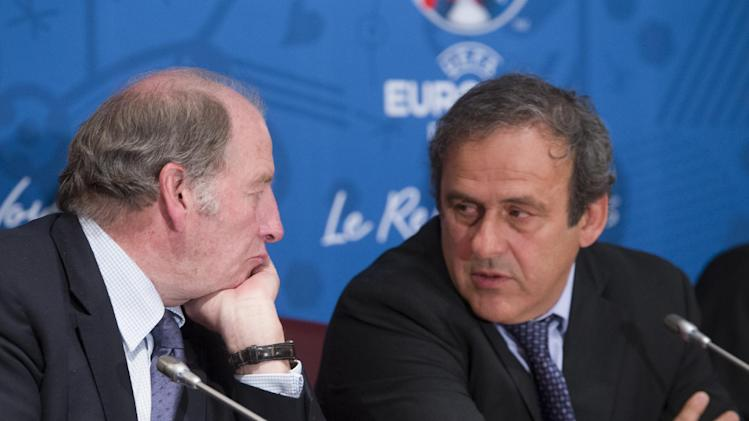 French President of the Euro 2016 organizing committee Jacques Lambert, left, speaks with UEFA president Michel Platini during a press conference for the presentation of the 2016 European Football Championship in Paris, Friday April 25, 2014. The Euro 2016 championship will run from June 10 to July 10, 2016. (AP Photo/Jacques Brinon)