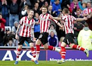 Sunderland's James McClean (L) celebrates scoring a goal with teammates Nicklas Bendtner (C) and Phil Bardsley during their English Premier League match at The Stadium of Light in Sunderland, on April 28. Sunderland host Manchester United next, on Sunday