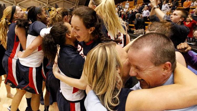 Penn head coach Mike McLaughlin, right, celebrates with assistant coach Bernadette Laukaitis after his team beat Princeton 80-64 after an NCAA college basketball game, Tuesday, March 11, 2014, in Princeton, N.J. The victory gives Penn the Ivy League title. (AP Photo/Julio Cortez)