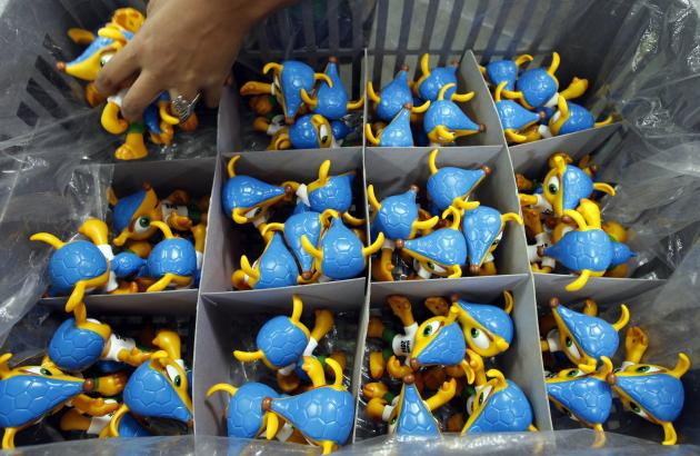 Employee makes toys of Fuleco the Armadillo, the official mascot of the FIFA 2014 World Cup, at a factory in Sao Bernardo do Campo
