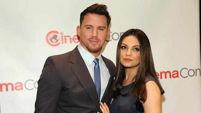 """Channing Tatum, left, and Mila Kunis, cast members in the upcoming film """"Jupiter Ascending,"""" pose together before the Warner Bros. presentation at CinemaCon 2014 on Thursday, March 27, 2014, in Las Vegas. (Photo by Chris Pizzello/Invision/AP)"""