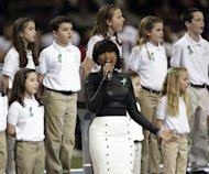 Jennifer Hudson, center, sings &quot;God Bless America&quot; before the NFL Super Bowl XLVII football game between the San Francisco 49ers and the Baltimore Ravens, Sunday, Feb. 3, 2013, in New Orleans. (AP Photo/Evan Vucci)