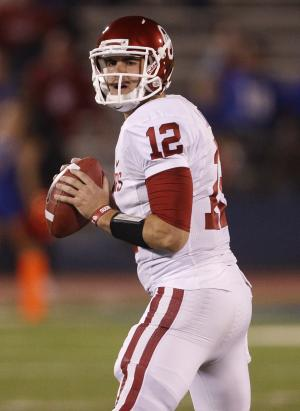 Oklahoma quarterback Landry Jones (12) looks for a receiver during the first half of an NCAA college football game against Kansas in Lawrence, Kan., Saturday, Oct. 15, 2011. (AP Photo/Orlin Wagner)