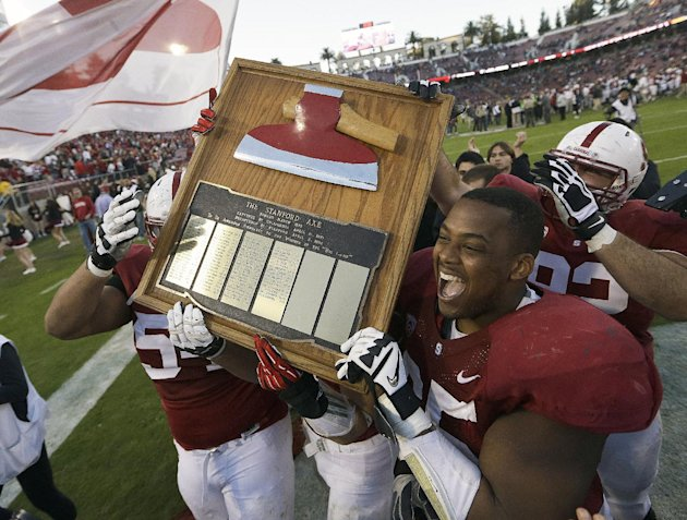 Stanford players celebrate with The Stanford Axe after a win over California in an NCAA college football game in Stanford, Calif., Saturday, Nov. 23, 2013. Stanford won 65-13. (AP Photo/Tony Avelar)
