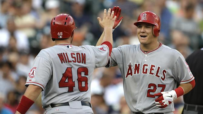 Los Angeles Angels' Mike Trout (27) is congratulated by Bobby Wilson (46) after hitting a two-run home run against the Detroit Tigers in the second inning of a baseball game in Detroit, Tuesday, July 17, 2012. (AP Photo/Paul Sancya)