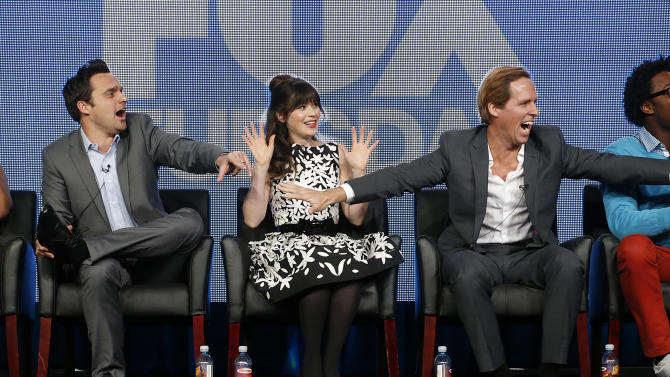 Jake Johnson,  Zooey Deschanel and Nat Faxon attend the Fox Winter TCA Tour at the Langham Huntington Hotel on Tuesday, Jan. 8, 2013, in Pasadena, Calif. (Photo by Todd Williamson/Invision/AP)