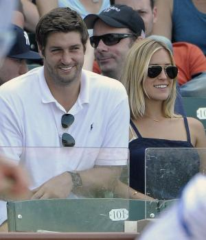 """FILE - In this July 2, 2011, file photo, Chicago Bears quarterback Jay Cutler, center, and Kristin Cavallari watch the Chicago Cubs play the Chicago White Sox during an interleague baseball game in Chicago. Cutler and Cavallari are engaged again. The reality TV star announced the engagement Wednesday, Nov. 30, 2011, on her Twitter feed, saying: """"This time its official..Jay and I are engaged again :)."""" (AP Photo/Brian Kersey, File)"""