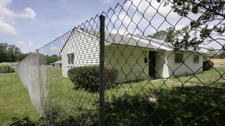 This Wednesday, May 9, 2007 file photo shows some older unoccupied housing in the Tarawa Terrace neighborhood in Camp Lejeune, N.C. The sprawling installation is the site of one of the worst drinking water contaminations in U.S. history. (AP Photo/Gerry Broome)