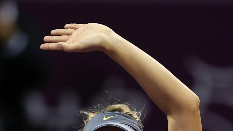 Maria Sharapova of Russia celebrates winning her singles match against Czech Republic's Klara Zakopalova during the fourth day of the WTA Qatar Ladies Open tennis tournament in Doha, Qatar, Thursday , Feb. 14, 2013. (AP Photo/Osama Faisal)