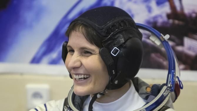 Samantha Cristoforetti of Italy smiles after donning her space suit at the Baikonur cosmodrome