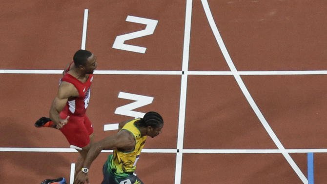 Jamaica's Usain Bolt, bottom, crosses the finish line to win the 100 meters before Jamaica's Yohan Blake, and Justin Gatlin, second from bottom and Tyson Gay from the U.S., top, during the athletics competition in the Olympic Stadium at the 2012 Summer Olympics, London, Sunday, Aug. 5, 2012. (AP Photo/David J. Phillip)