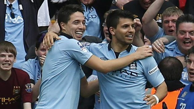 DATE IMPORTED:April 14, 2013Manchester City's Sergio Aguero (R) celebrates with Samir Nasri after scoring against Chelsea during their FA Cup semi-final match at Wembley Stadium in London