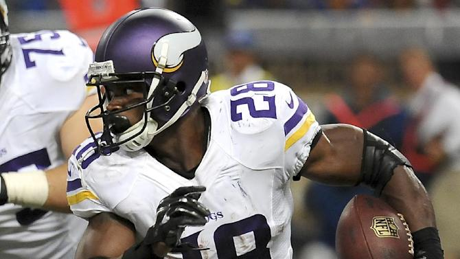 In this Sept. 7, 2014, file photo, Minnesota Vikings running back Adrian Peterson carries the ball agianst the St. Louis Rams during the third quarter an NFL football game in St. Louis.  After a day of public pressure from angry fans and concerned sponsors, the Vikings have reversed course and placed star  Peterson on the exempt-commissioner's permission list, the team announced Wednesday, Sept. 17, 2014. The move that will require him to stay away from the team while he addresses child abuse charges in Texas