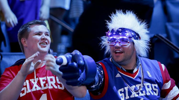 Philadelphia 76ers fans react before the start of the 2014 NBA draft, Thursday, June 26, 2014, in New York
