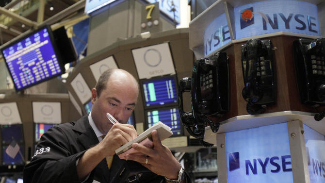 Trader Christopher Morie works on the floor of the New York Stock Exchange Tuesday, June 7, 2011. (AP Photo/Richard Drew)
