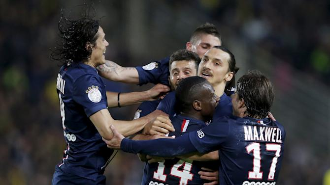 Paris St Germain's Blaise Matuidi (bottom C) celebrates with his team mates after scoring against FC Nantes during their French Ligue 1 soccer match at the Beaujoire stadium in Nantes, France