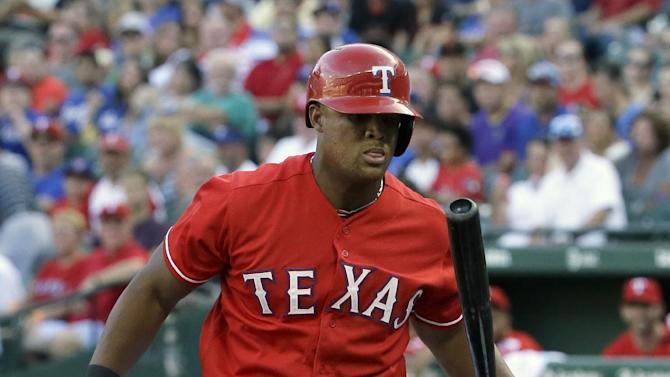 Texas Rangers' Adrian Beltre tosses his bat after taking a strike during the second inning of a baseball game against the San Francisco Giants in Arlington, Texas, Saturday, Aug. 1, 2015. (AP Photo/LM Otero)