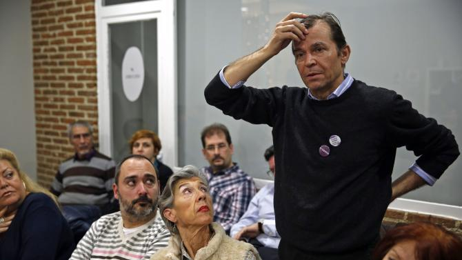 A man speaks at a local assembly of Podemos at Madrid's Salamanca district