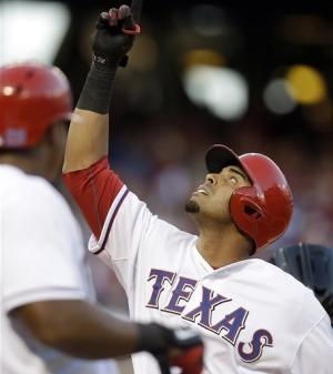 Holland strong for Texas in 7-2 win over tired KC