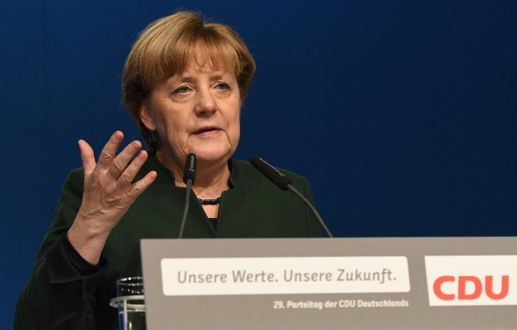 Merkel's party wants dual nationality rule scrapped
