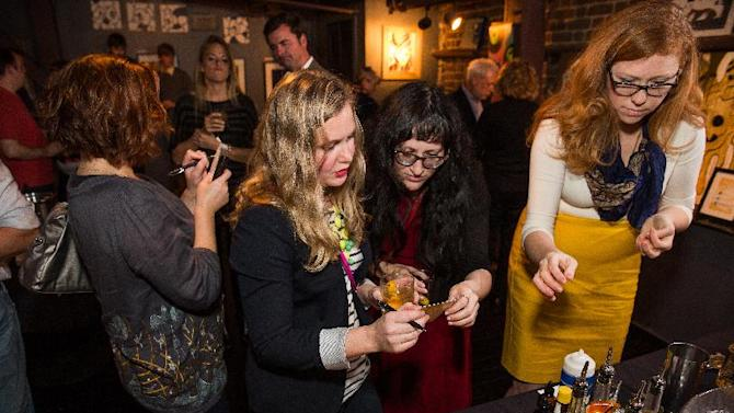 IMAGE DISTRIBUTED FOR CROWN ROYAL - Guests participate in a cocktail-making contest during the Charleston Crown Royal Maple Finished launch party at the Social Restaurant + Wine Bar on Wednesday, Jan. 30, 2013, in Charleston, S.C. (Mic Smith/AP Images for Crown Royal)