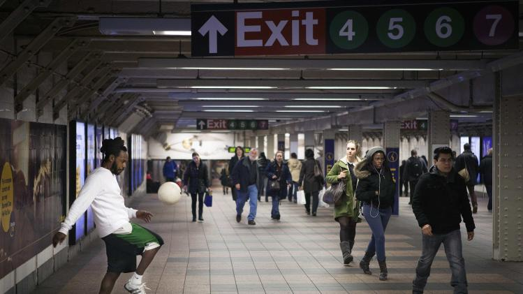 Ezekiel Emanuel practices playing soccer in the 42nd St subway station in New York
