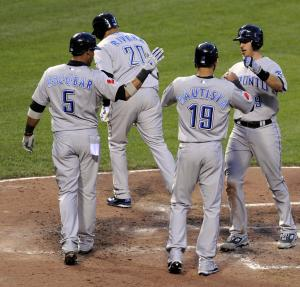 Toronto Blue Jays' J.P. Arencibia, right, is greeted by teammates Jose Bautista, Yunel Escobar and Juan Rivera after hitting a grand slam against the Baltimore Orioles in the fifth inning of a baseball game, Friday, June 3, 2011, in Baltimore. (AP Photo/Gail Burton)